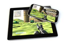 Smartphone and tablet gaming Stock Photos