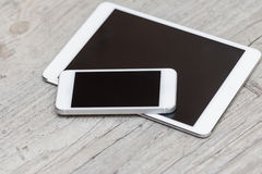 Smartphone and tablet on the gray wooden background Stock Photo