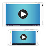 Smartphone and tablet with media playing on a screen Royalty Free Stock Photography