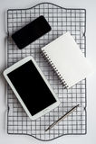 Smartphone, Tablet and Notepad Stock Image