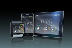Smartphone tablet pc and futuristic wristwatch. On black background