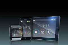 Smartphone tablet pc and futuristic wristwatch. On black background Stock Photo