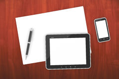Smartphone and tablet PC on a table with a blank screen Royalty Free Stock Image
