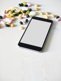 Smartphone tabletts, online-handel Arkivbild