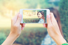 Smartphone taking Asia teen relax Royalty Free Stock Images
