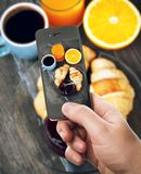Smartphone taking food photo of breakfast Royalty Free Stock Photos