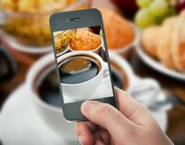 Smartphone taking food photo of breakfast Royalty Free Stock Images