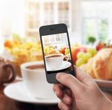 smartphone taking photo of breakfast Royalty Free Stock Photo