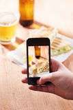 Smartphone taking photo of feta cheese sandwich Royalty Free Stock Photography