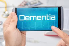 Smartphone with the text Dementia. On the display stock photo