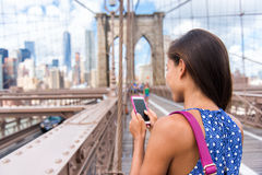 Smartphone texting woman in urban New York City Stock Photos