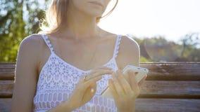 Smartphone tocante da mulher Fotos de Stock Royalty Free