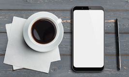 Smartphone top view on old wood table with stylus and coffee. Smartphone top view on gray wood table with pen and coffee Royalty Free Stock Photo
