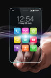 Smartphone transparent avec les apps colorés sur le fond noir Photos stock
