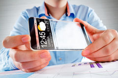 Smartphone with transparent screen in human hands. Stock Photos