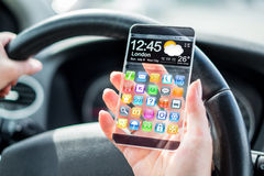 Smartphone with transparent screen in human hands. Royalty Free Stock Photography
