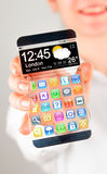 Smartphone with transparent screen in human hands. Stock Photo