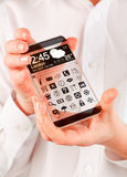 Smartphone with transparent screen in human hands. Stock Photography