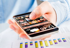 Smartphone with transparent screen in human hands. Stock Image