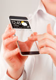 Smartphone with transparent screen in human hands. Royalty Free Stock Images