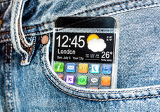 Smartphone with a transparent screen in a pocket of jeans. Royalty Free Stock Image