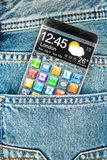 Smartphone with a transparent screen in a pocket of jeans. Royalty Free Stock Photo