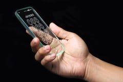 Smartphone transparente com mão no fundo escuro Imagens de Stock Royalty Free