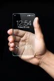 Smartphone transparente com mão no fundo preto Fotos de Stock Royalty Free