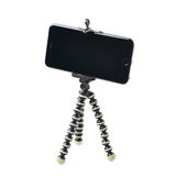 Smartphone on a tripod isolated Stock Images