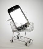 Smartphone in un carrello di acquisto Fotografia Stock Libera da Diritti