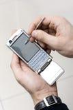 Smartphone in una mano Immagini Stock