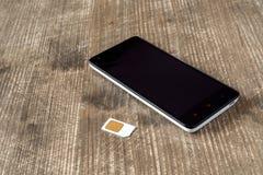Smartphone und SIM Karte Stockbilder