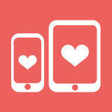 Smartphone und Tablette mit Herzvektorikone Stockbild