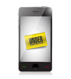 Smartphone with an under construction signage Stock Photography