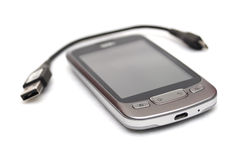 Smartphone and usb cable Stock Image