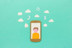 Smartphone with user profile surrounded by mobile communication and entertainment symbols Stock Photo