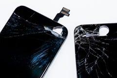 Smartphone uszkadzał i potrzeba naprawiać która wytłacza wzory smartphone zdjęcie stock