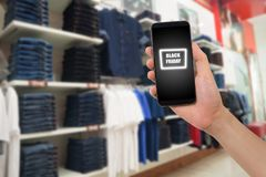 Smartphone van de handgreep, tablet, celtelefoon met zwarte Vrijdagteksten Royalty-vrije Stock Foto