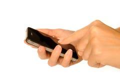 Smartphone van de holding Stock Afbeeldingen