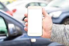 Smartphone van de mensenholding met het lege lege witte scherm stock foto