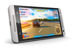 Smartphone with video game. Creative abstract mobile gaming and computer entertainment technology concept: modern black glossy touchscreen smartphone with video Stock Photo