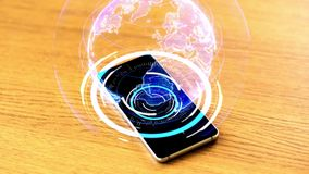 Smartphone with virtual earth projection on table. Virtual reality and technology concept - smartphone with 3d projection of earth on wooden table stock footage
