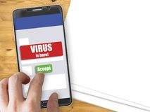 Smartphone with virus notification and accept button. Mobile phone mockup with red virus warning notification and green accept button Royalty Free Stock Images