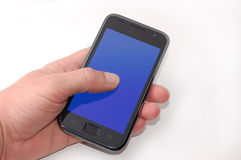 Smartphone in vostra mano Fotografie Stock Libere da Diritti