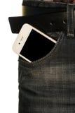 Smartphone w kieszeni cajgi Zdjęcia Stock