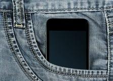 Smartphone w twój kieszeniowych szarych cajgach Zdjęcia Stock