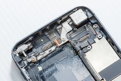 The smartphone was damages and need to repair which tools smartphone that stand on white background. By hands of repairman royalty free stock image