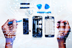 The smartphone was damages and need to repair which tools smartphone that stand on white background. By hands of repairman stock images