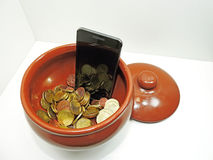 Smartphone on white background in pot Royalty Free Stock Photos