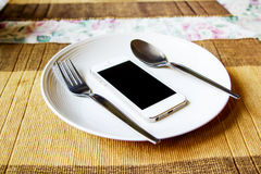 Smartphone in the white dish. Stock Photo